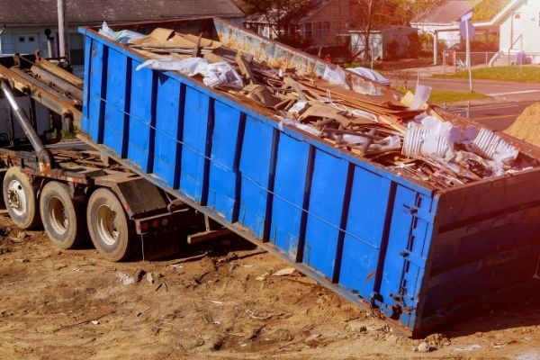 blue container filled with rock and debris