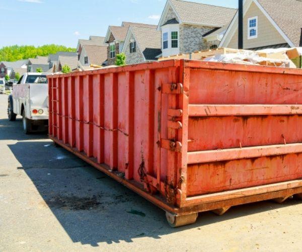 filled orange skip container